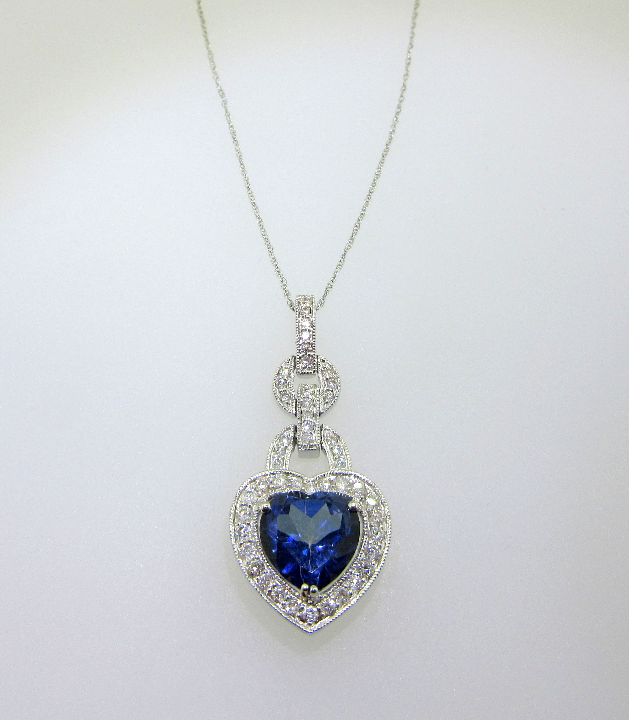 Diamond & Blue Topaz Pendant
