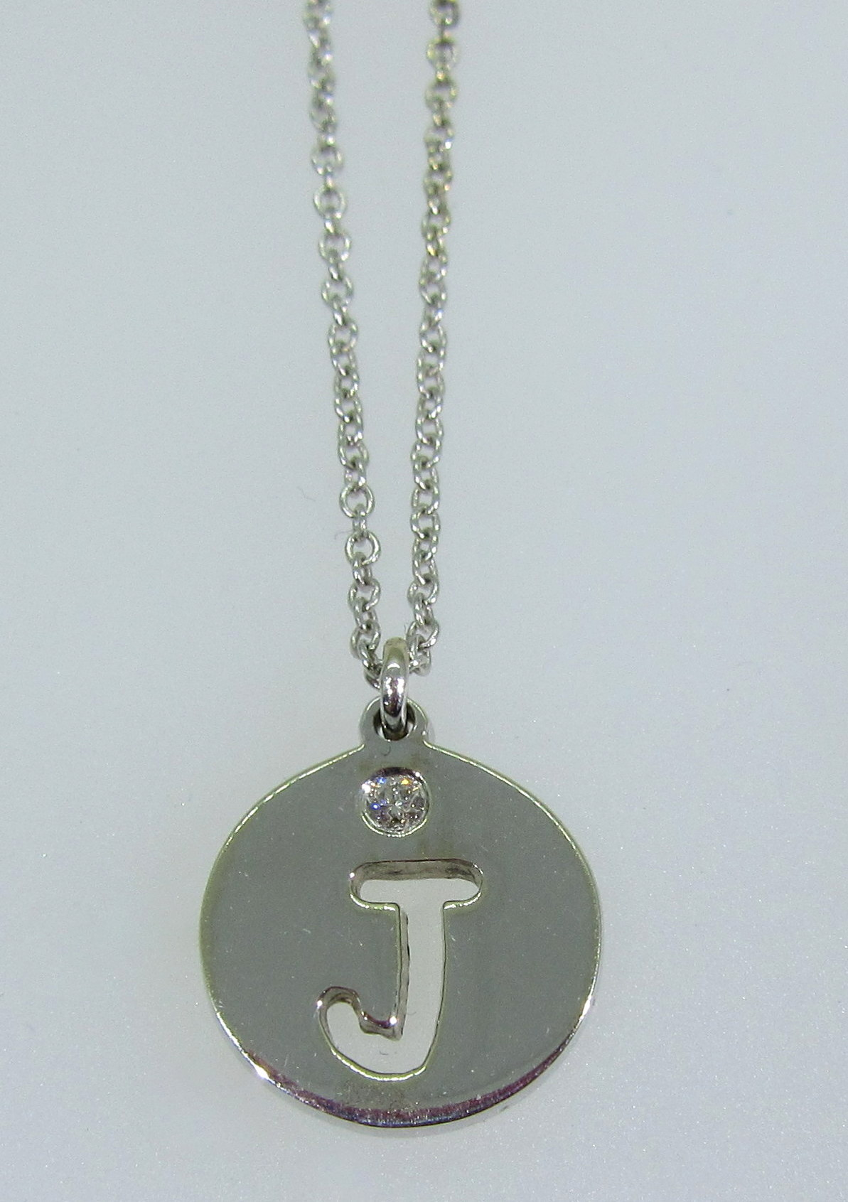 """J"" Diamond Cut Out Initial Pendant"